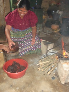 One of the women of the cooperative in Guatemala preparing a dye bath using tree bark. 2010